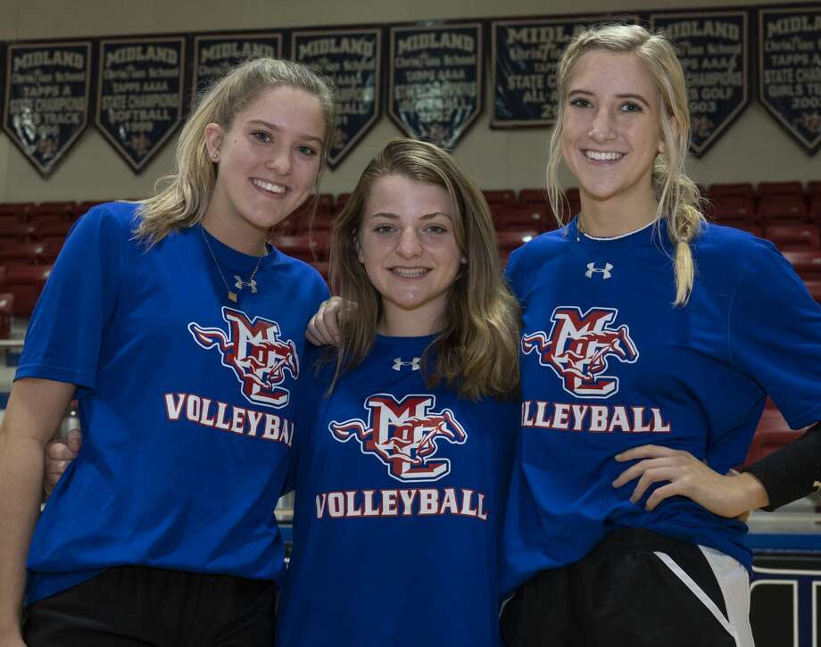 Midland Christian sisters, Ella Sheppard, left, Andie Sheppard, right and Gracie Truex, middle, and her sister Faith Truex, not pictured, on the volleyball team. 10/02/19  Tim Fischer/Reporter-Telegram Photo: Tim Fischer/Midland Reporter-Telegram