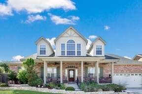 426 Williams Way, New Braunfels, TX 78130 Stunning custom home! 6 bdrm, 3 bth, 4,247 sq ft. This beautiful home has an open floor plan that includes a Living, Breakfast and Kitchen with a large breakfast bar and soaring high ceilings. Downstairs master bedroom has two walk-in closets, and 6x9 walk-in shower plus whirlpool tub. There is an auxiliary kitchen upstairs with a small dining area located in a large media room for entertaining. Texas size covered patio overlooks terraced backyard. The two car garage is air-conditioned and includes an additional 20x20 workshop/gym/art or dance studio. Contact: Kristen Kayata (210) 303-5122; kristenkayata@kw.com Keller Williams Heritage