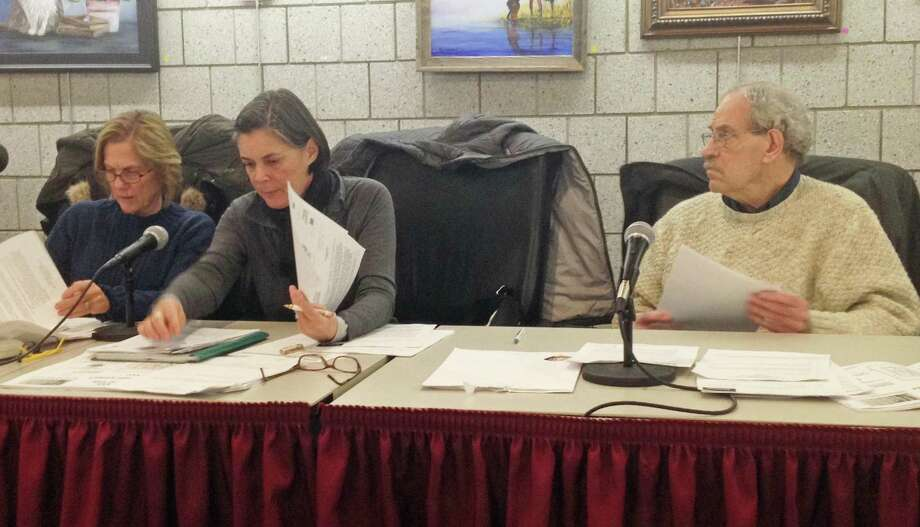 In this file photo Chairman Bruce Tyler, far right, and commission members Chantal Foster, center, and left, Carolyn Free, and the Elmcrest proposal in Portland. Photo: Jeff Mill / Hearst Connecticut Media /