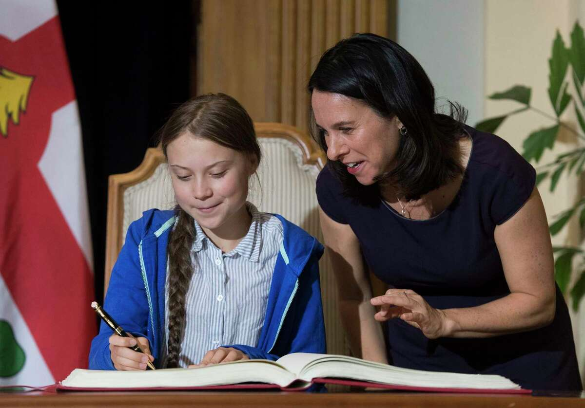Swedish climate activist Greta Thunberg, left, signs the Golden Book next to Montreal Mayor Valerie Plante during a ceremony in Montreal. A reader decries criticism of her recent speech at the United Nations climate action summit.