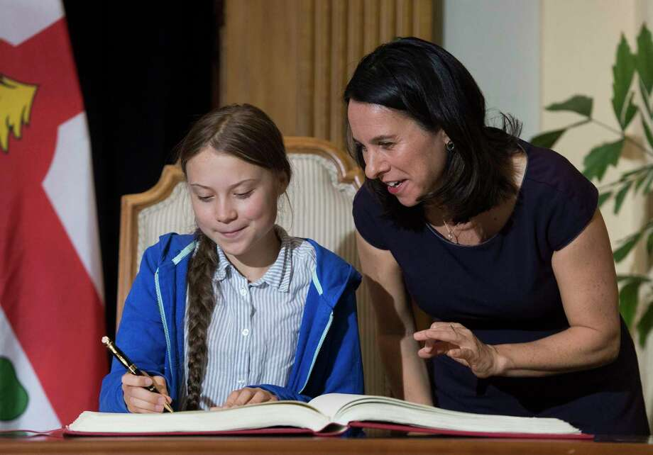 Swedish climate activist Greta Thunberg, left, signs the Golden Book next to Montreal Mayor Valerie Plante during a ceremony in Montreal. A reader decries criticism of her recent speech at the United Nations climate action summit. Photo: Graham Hughes /Associated Press / The Canadian Press