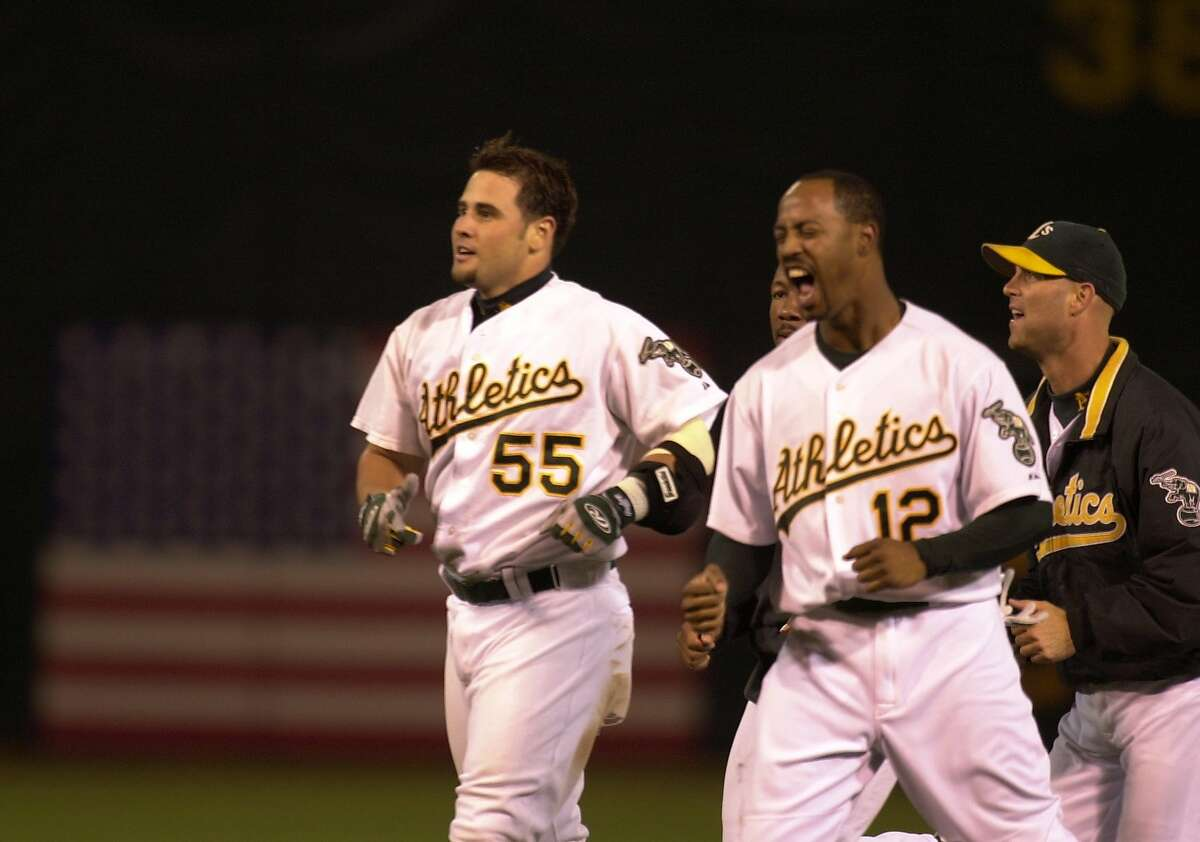 athletics7_012_LA.jpg Athletics #55 Ramon Hernandez celebrates his twelth inning game winning bunt with his teammates. The Oakland Athletics play the Boston Red Sox in Game 1 of the American League Division Series at Oakland Coliseum 10/1/03 in Oakland. Lacy Atkins / The Chronicle
