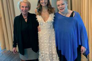 Two-time cancer survivor Vicki Looney (right), Karen Olagues (left), and Vicki's granddaughter Grace Looney (center) celebrate as Vicki is honored for her service with the National Charity League. Vicki encourages other women to get their mammograms, even after natural disasters like Hurricane Harvey or Tropical Storm Imelda.