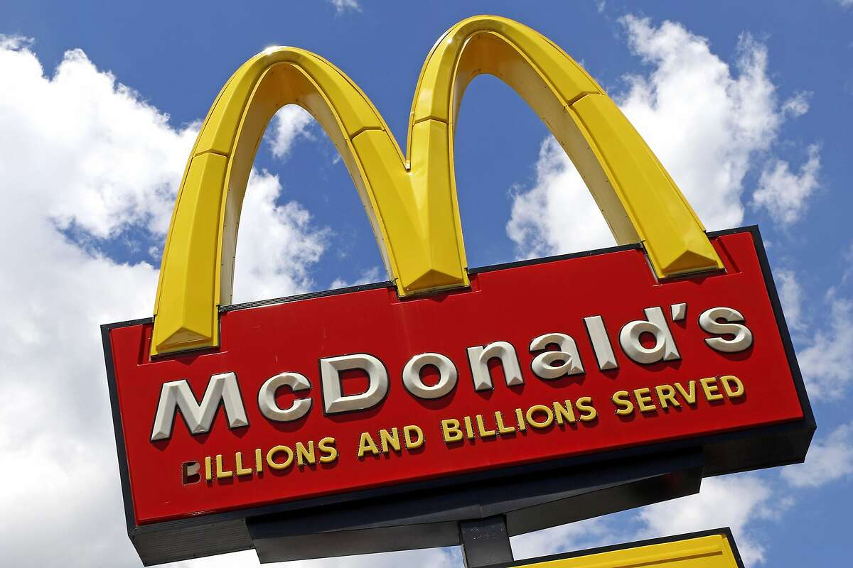 FILE - This Tuesday, June 25, 2019, photo shows the sign outside a McDonald's restaurant in Pittsburgh. Starting Wednesday, Sept. 25, 2019, McDonald's Corp. will let job seekers start an application by using voice commands on their smartphones with Amazon's Alexa or Google's Assistant. (AP Photo/Gene J. Puskar, File)