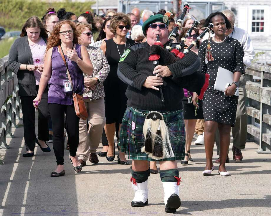 Mike Torino of the New Haven County Firefighters Emerald Society Pipes & Drums Corp plays the bagpipe as he leads a procession for the Sound of Hope event to bring attention to the victims of domestic violence at Long Wharf Pier in New Haven on October 2, 2019. Photo: Arnold Gold / Hearst Connecticut Media / New Haven Register