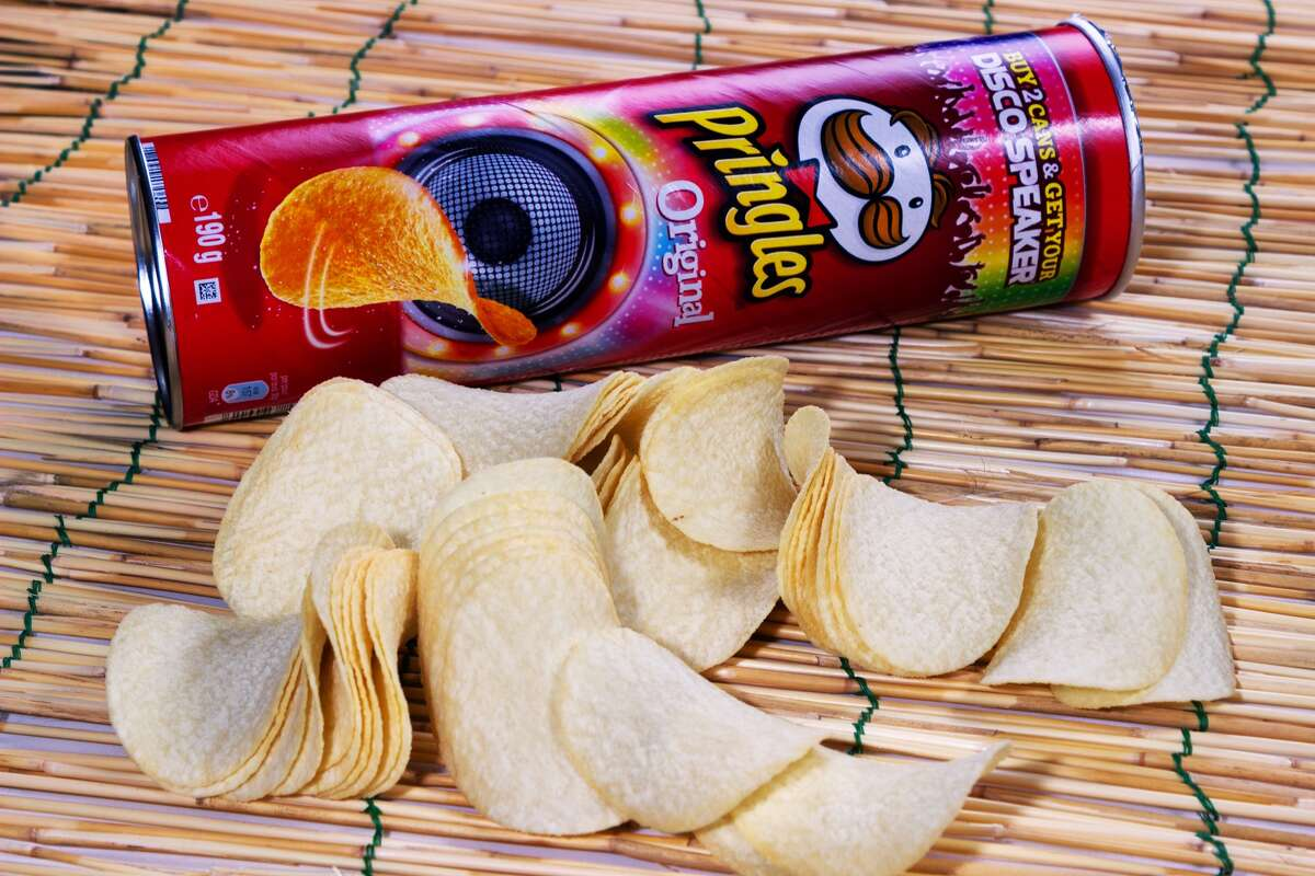 NO, DON'T RECYCLE: Pringles potato chips containers. The container is cardboard, the rims are metal, the insides are coated with aluminum foil. Multiple packaging materials are the scourge of recycling, and Kellogg's, the maker of Pringles, should know better.