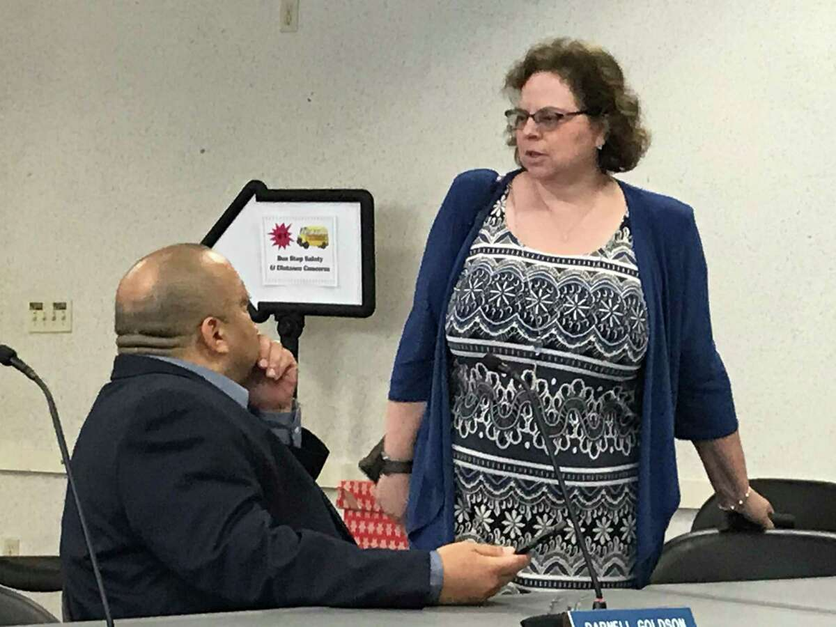 Board of Education President Darnell Goldson with the board's lawyer, Melinda Kaufmann.