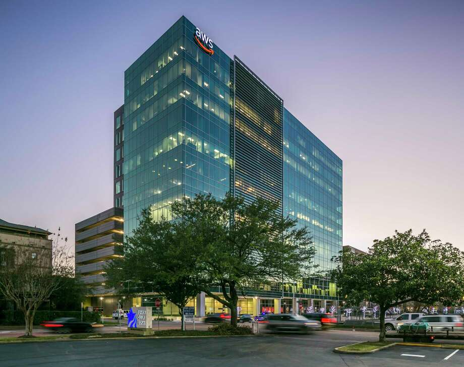 Lionstone Investments, on behalf of a client,purchased majority interest in CityCentre Five, a 15-story office building at 825 Town & Country Lane from Midway Cos. Midway will continue to managethe property on behalf of the new venture. Photo: JLL, Photographer / Mabry Campbell / Copyright 2019 Mabry Campbell