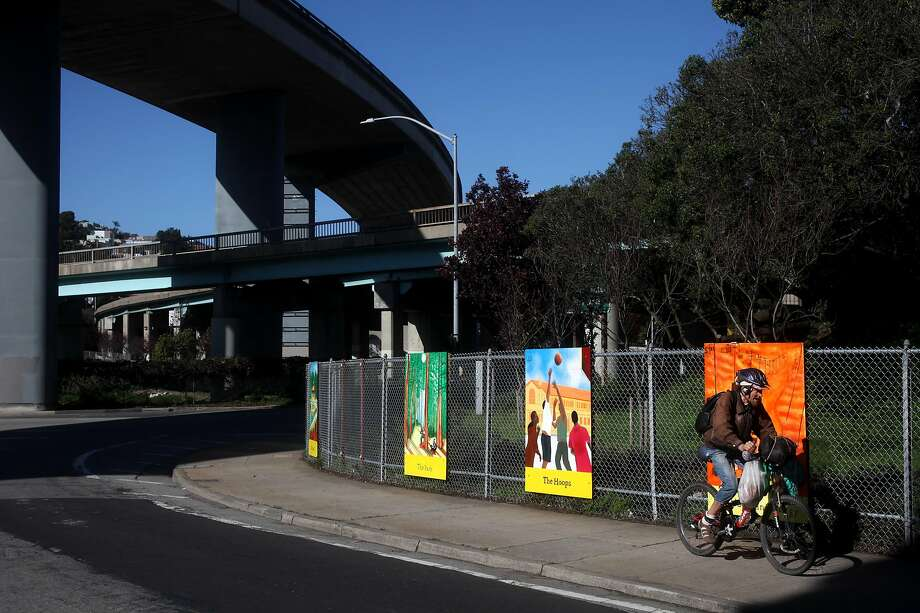 A cyclist rides past finished panels on San Bruno Avenue and Rickard Streeet underneath U.S. 101 South in San Francisco. Caltrans announced  that it plans to rebuild the deck of U.S. 101 at Alemany Circle. The project will begin in July and will take three weeks to complete. Photo: Leah Millis / The Chronicle 2014