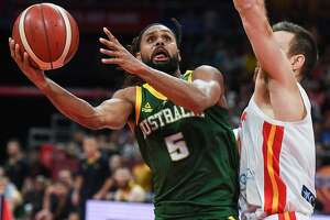 Australia's Patty Mills (L) fights for the ball with Spain's Victor Claver during the Basketball World Cup semi-final game between Australia and Spain in Beijing on September 13, 2019. (Photo by Greg BAKER / AFP)GREG BAKER/AFP/Getty Images