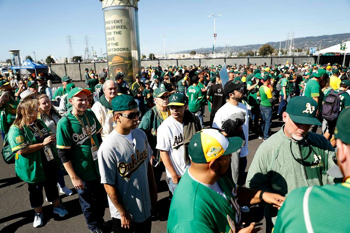 Oakland Athletics' fans wait to enter the stadium before A's play Tampa Bay Rays in American League Wild Card game at Oakland Coliseum in Oakland, Calif., on Wednesday, October 2, 2019.