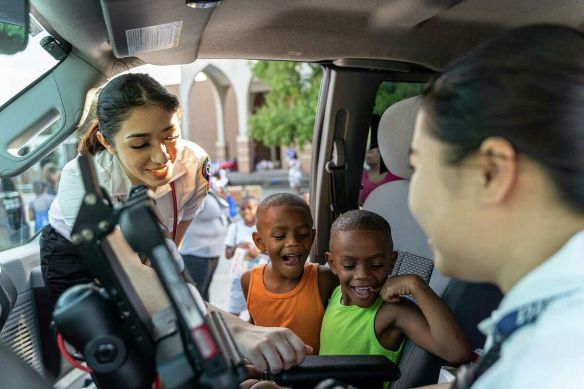 Community members in Spring interacting with Spring ISD police officers Tuesday during National Night Out. The annual event is a chance for residents to meet with and become more familiar with the law enforcement officers in their community.