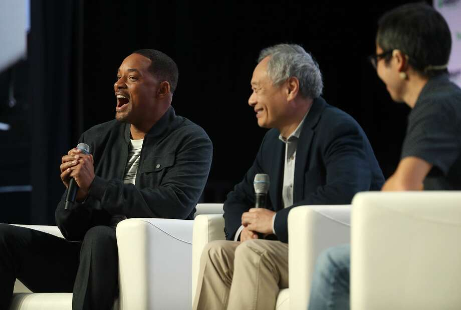 SAN FRANCISCO, CALIFORNIA - OCTOBER 02: Actor Will Smith (L) speaks as director Ang Lee (R) looks on during the TechCrunch Disrupt SF 2019 conference at Moscone Center on October 02, 2019 in San Francisco, California. TechCrunch Disrupt puts the spotlight on revolutionary startups and innovators. The three-day conference features interviews with industry leading entrepreneurs, investors and hackers. TechCrunch Disrupt SF runs through October 4. (Photo by Justin Sullivan/Getty Images) Photo: Justin Sullivan/Getty Images
