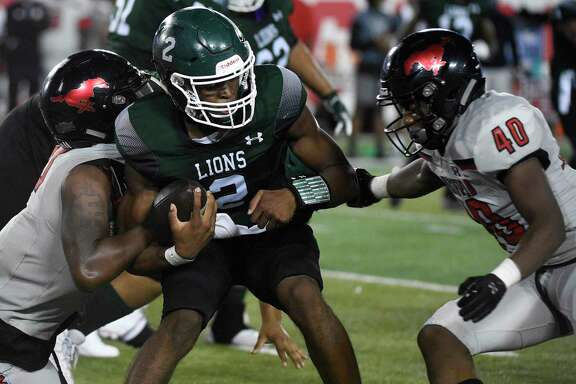 Spring quarterback Aldyn Bradley, center, is sacked by Westfield defensive lineman William Hatter, left, and linebacker Ashton Harris (40) during the second half of a high school football game, Friday, Sept. 27, 2019, in Houston.