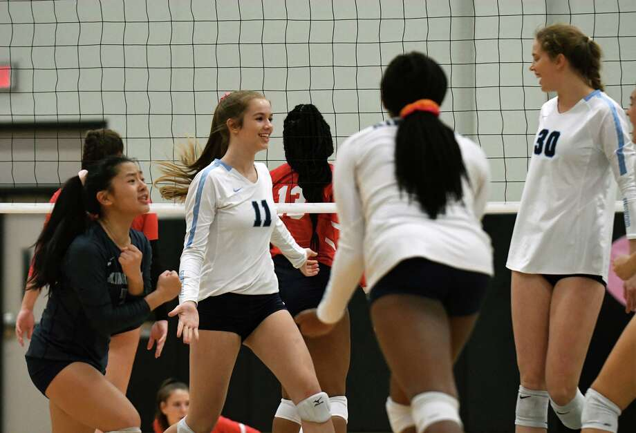 Kingwood's Lizzy Young, from left, Hannah Smith (11), Breanna Burrell and Megan Wilson (30) celebrate a point against Atascocita during the first set of their District 22-6A matchup at Kingwood Park High School on Oct. 1, 2019. Photo: Jerry Baker, Houston Chronicle / Contributor / Houston Chronicle