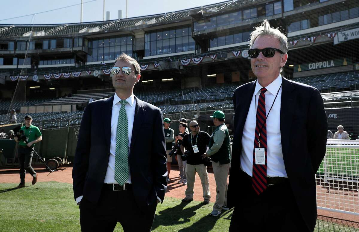 Dave Kaval, President of the Oakland A's and Billy Beane, executive VP of baseball operaitons on the field watching warm ups before the Oakland Athletics played the Tampa Bay Rays at the Oakland Coliseum in the Wild Card playoff game in Oakland, Calif., on Wednesday, October 2, 2019.