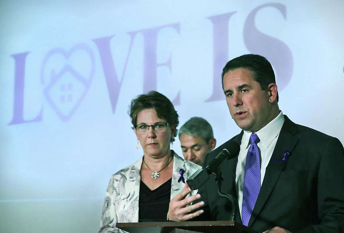 """City Manager Erik Walsh, right, speaks with Assistant City Manager Colleen Bridger, left, and Mayor Ron Nirenberg, center, as the City of San Antonio unveils a new campaign called """"Love Is..."""", to raise awareness about domestic violence locally."""