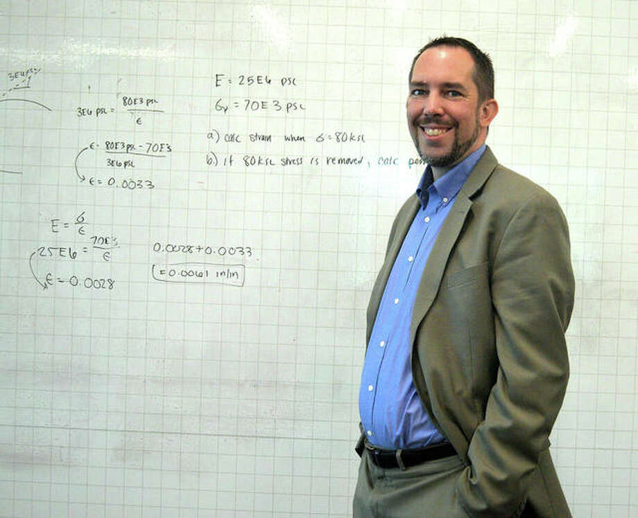 Chris Gordon, associate dean of the SIUE School of Engineering, stands in front of a whiteboard wall in the Grady Family Foundation Innovation Loft, located on the second floor of the new Fowler Student Design Center. Photo: Scott Marion | The Intelligencer