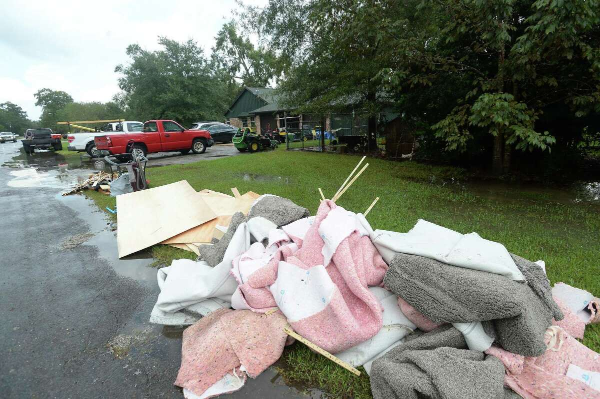 Debbris and carpeting sits outside Sheila Hight River Bend Road home in Bevil Oaks, whose evacuation order was lifted late Sunday. Many residents were already in the process of clearing out and gutting their homes Monday morning. Hight's home got over six feet of flooding in Harvey, but she and husband Ernie were able to repair.