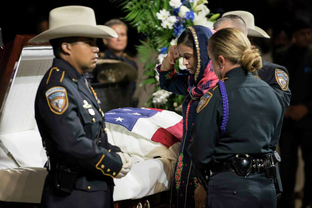Harwinder Kaur Dhaliwal, widow of Harris County Sheriff's Deputy Sandeep Dhaliwal salutes as she honors her husband during his funeral at Berry Center on Wednesday, Oct. 2, 2019, in Houston. Dhaliwal was killed in the line of duty Friday, when he was shot and killed during a traffic stop.