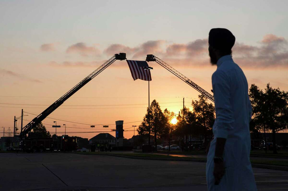 A huge American flag is hung at the entrance of Berry Center, where two funeral ceremonies for the fallen Harris County Sheriff's Deputy Sandeep Dhaliwal is held, on Wednesday, Oct. 2, 2019, in Cypress. Dhaliwal, a trailblazer and 10-year veteran of the agency, was killed in an ambush during a traffic stop last Friday.