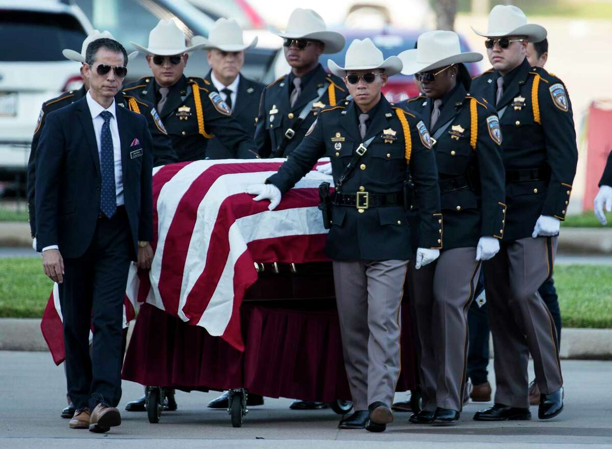 An honor guard escorts the casket of Harris County Sheriff's Deputy Sandeep Dhaliwal for his funeral at Berry Center on Wednesday, Oct. 2, 2019, in Houston. Dhaliwal was killed in the line of duty Friday, when he was shot and killed during a traffic stop.