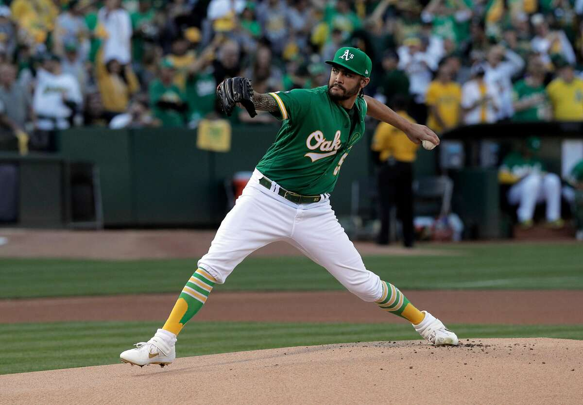 Sean Manaea (55) pitches as the Oakland Athletics played the Tampa Bay Rays at the Oakland Coliseum in the AL Wild Card playoff game in Oakland, Calif., on Wednesday, October 2, 2019.