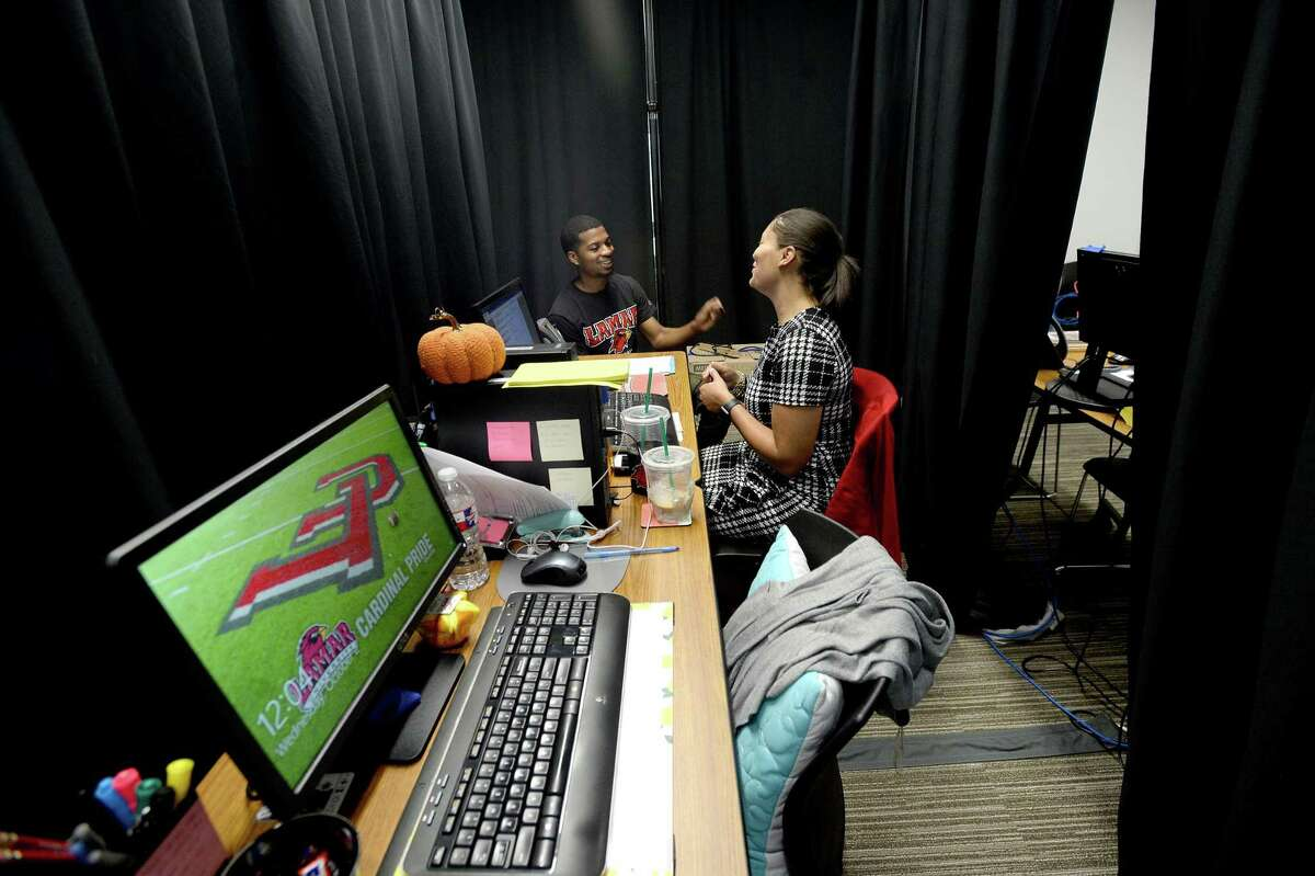 Lamar University academic advisor Tanya Celestine meets with Joshua Young at their temporary workrooms in the Setzer Center while awaiting repairs to the Carl Parker Building, which was among the most heavily damaged campus buildings during Imelda. The storm and flooding affected several locations throughout the campus. Photo taken Wednesday, October 02, 2019 Kim Brent/The Enterprise