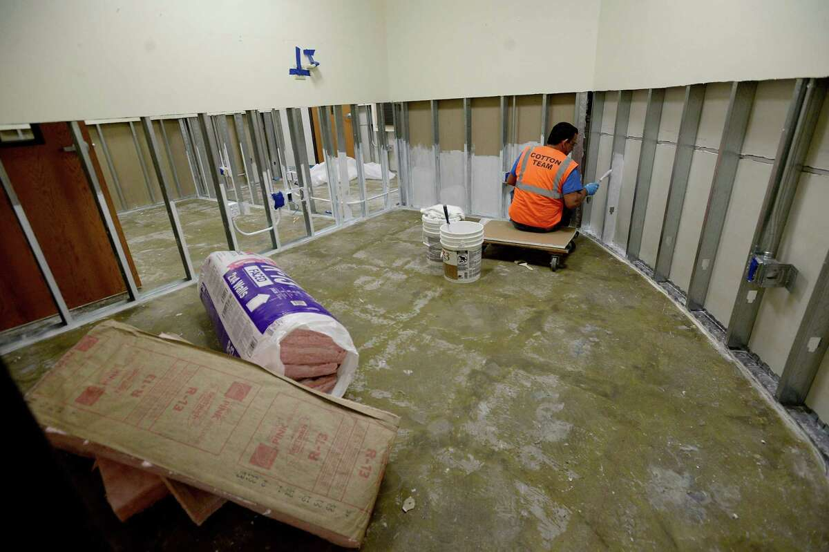 A team member with Cotton rebuilds an office space inside the Carl Parker Building, which was among several locations throughout the Lamar University campus that were impacted by Imelda. Photo taken Tuesday, October 01, 2019 Kim Brent/The Enterprise