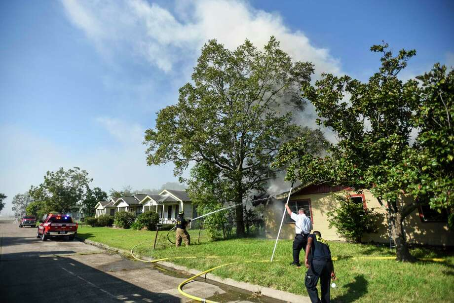 Port Arthur firefighters work on extinguishing remaining flames and hot spots after they responded to an abandoned house that was on fire in the 1000 block of Herget Ave. in Port Arthur Wednesday afternoon. Photo taken on Wednesday, 10/02/19. Ryan Welch/The Enterprise Photo: Ryan Welch, Beaumont Enterprise / The Enterprise / © 2019 Beaumont Enterprise