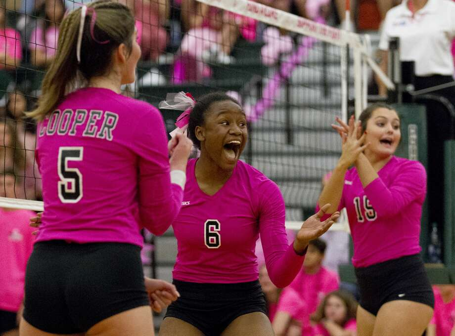 John Cooper's AJ Harrell (6) reacts after a point beisde Anna Claire Adam, left, and Valerie McKeever during the second set of a non-district high school volleyball match at The John Cooper School, Wednesday, Oct. 2, 2019, in The Woodlands. Photo: Jason Fochtman/Staff Photographer