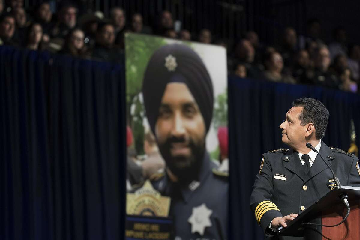 Harris County Sheriff Ed Gonzalez looks up at his District 5 deputies as he eulogizes deputy Sandeep Dhaliwal during the slain deputy's funeral at Berry Center on Wednesday, Oct. 2, 2019, in Houston. Dhaliwal was killed in the line of duty Friday, when he was shot and killed during a traffic stop.