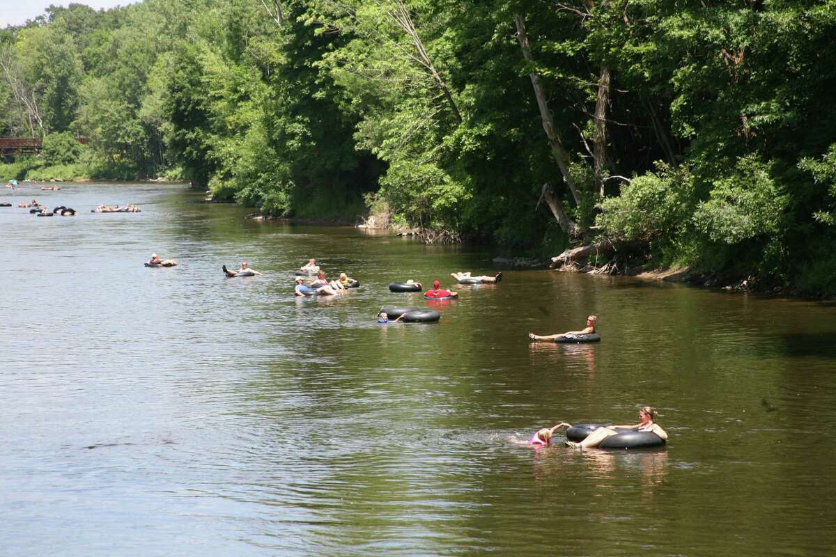 FLOAT DOWN: Tubers float down the Muskegon River on Tuesday. As temperatures reached higher than 90 degrees, many made their way to water to cool down.
