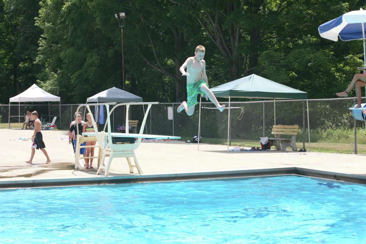 DIVING BOARD: Temperatures reached higher than 90 degrees on Tuesday. Nearly 200 people went to the Charles E. Fairman Community Pool to cool down.