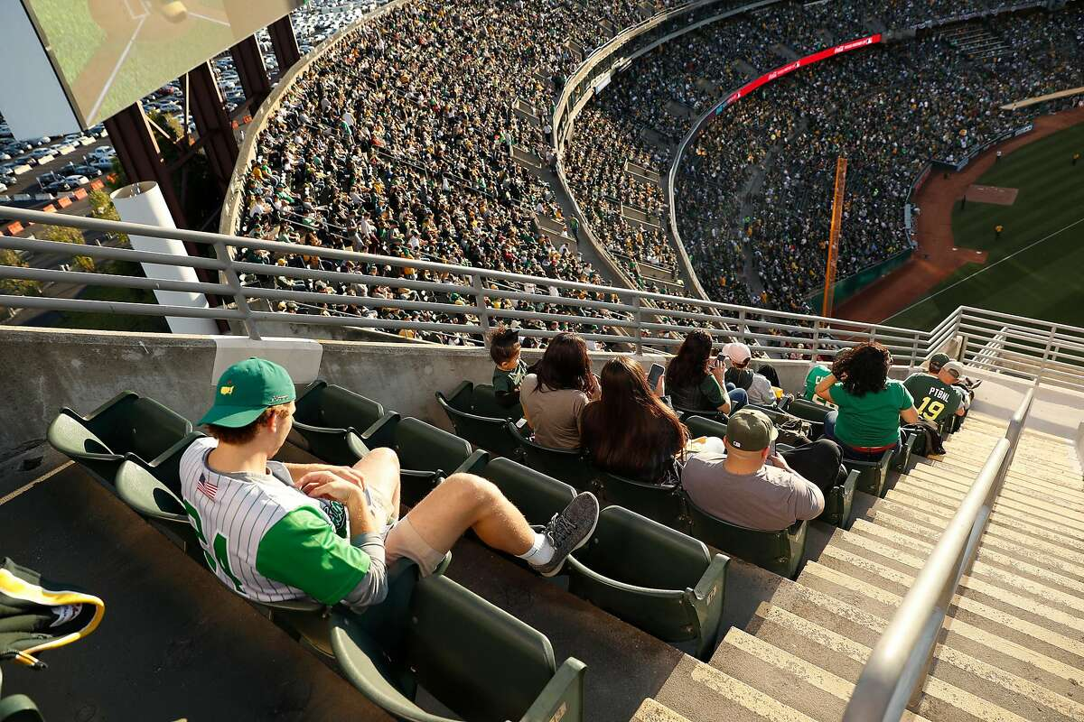 From Mt. Davis seating area, fans watch Oakland Athletics play Tampa Bay Rays in American League Wild Card game at Oakland Coliseum in Oakland, Calif., on Wednesday, October 2, 2019.