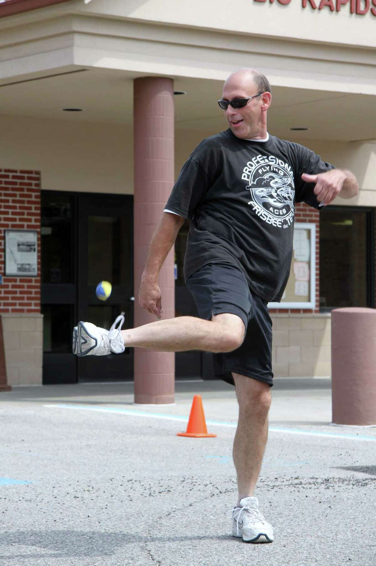 FLYING ACES: Jay Moldenhauer, 51, demonstrates different Frisbee throws. As the three-time world champion of hacky sack, he also showed off his hacky sack skills. (Pioneer photos/Lauren Fitch)
