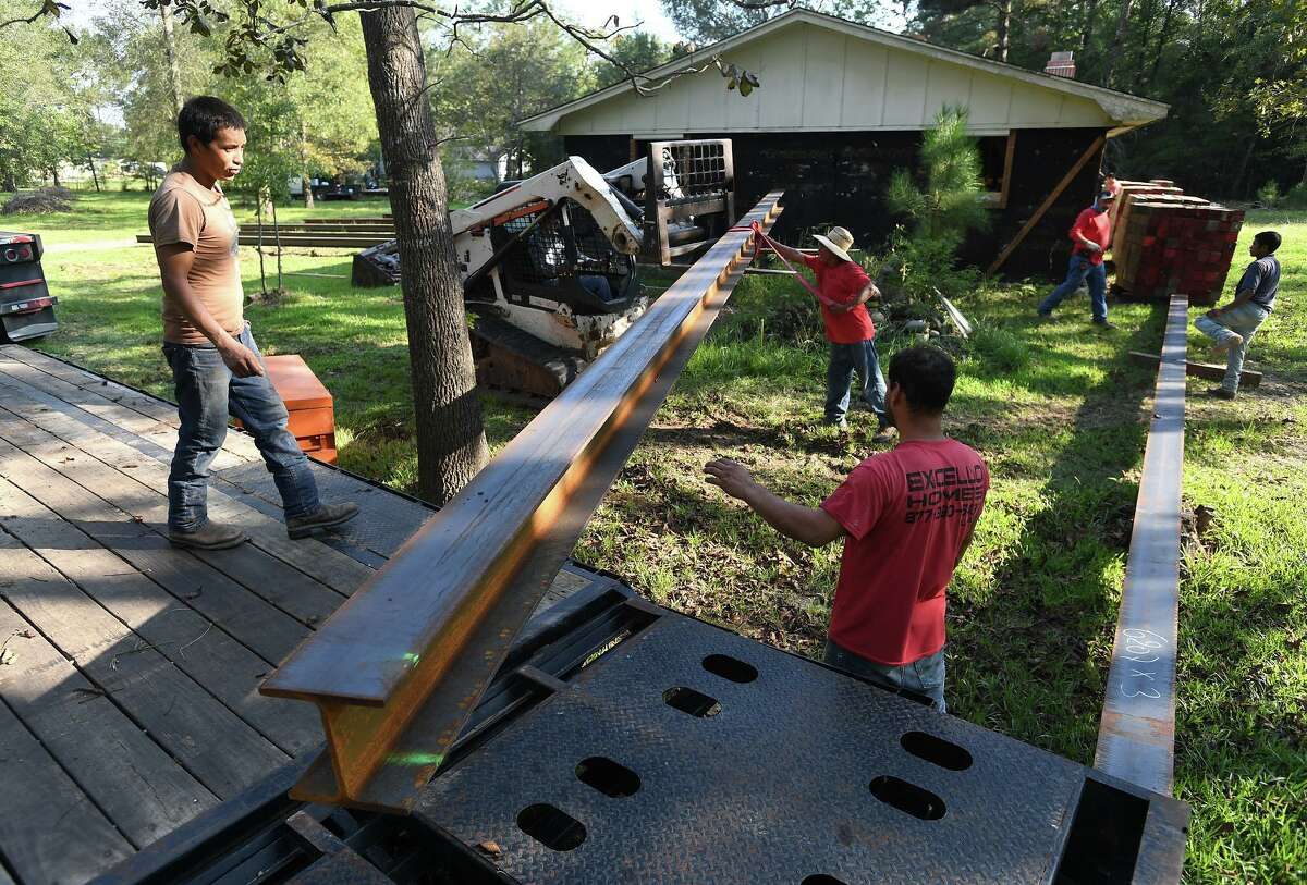 A work crew prepares a home to be raised at a Bevil Oaks home on Wednesday. Photo taken Wednesday, 10/2/19