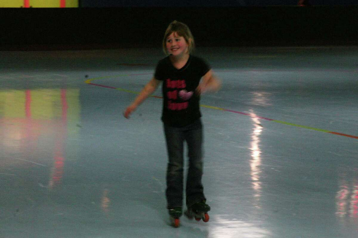 ROLLER RINK: Lea Nelson shows off her skating skills. She was one of the winners in the roller skating version of musical chairs. (Pioneer photos/Lauren Fitch)