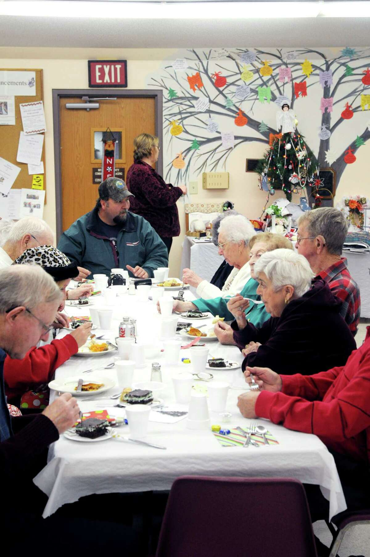 FEAST: Roughly 150 guests filled the Mecosta County Senior Center to celebrate the holidays at the center's annual Christmas dinner. Guests enjoyed a holiday spread that included marinated chicken breast, baked sweet potato and a mint dessert. (Pioneer photo/Kyle Leppek)