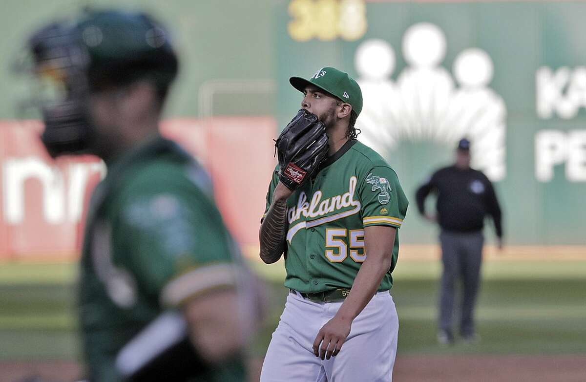 Sean Manaea (55) walks off the field after the second inning with the A's trailing 3-0 as the Oakland Athletics played the Tampa Bay Rays at the Oakland Coliseum in the AL Wild Card playoff game in Oakland, Calif., on Wednesday, October 2, 2019.