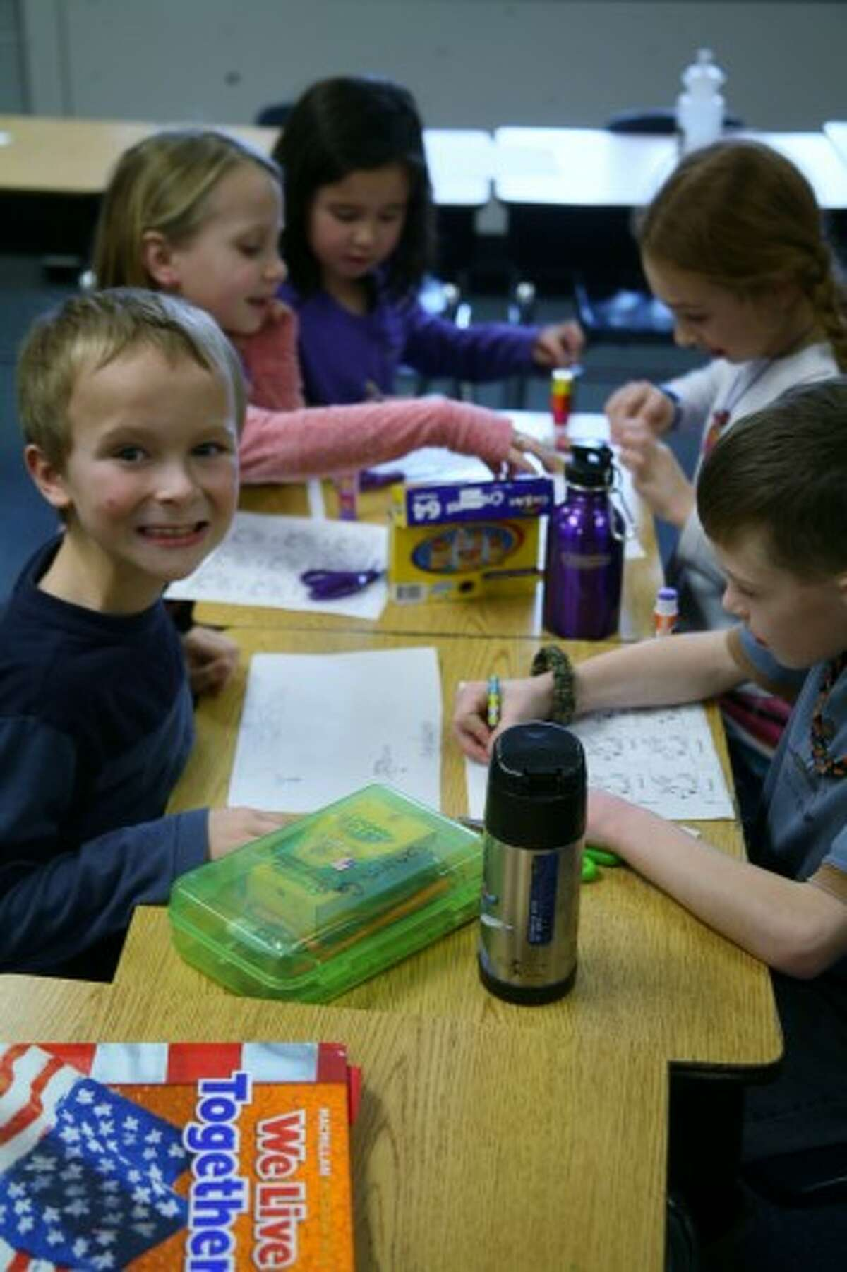 ALPHABETICAL: Second-grade students in Karen King's class at Brookside Elementary School work on an exercise on Thursday putting reindeer in alphabetical order by name. (Pioneer photos/Lauren Fitch)
