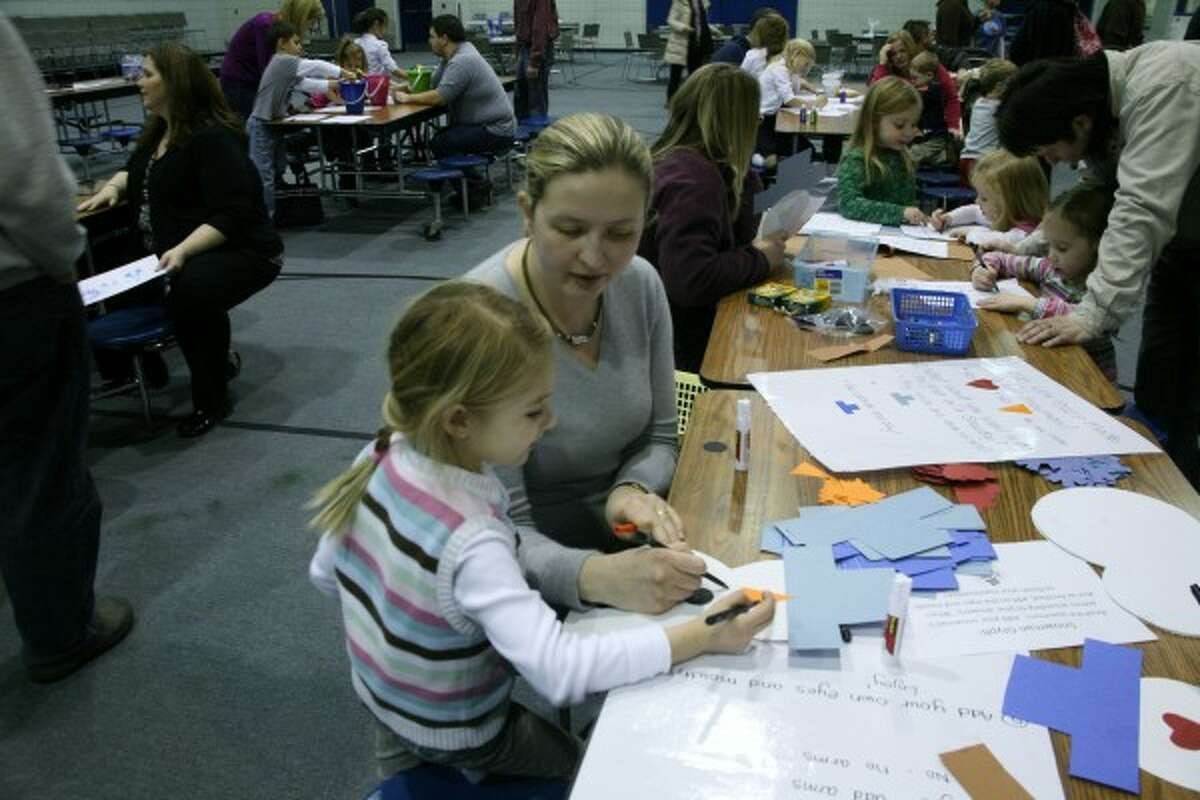WORKING TOGETHER: Lilia Caserta helps her daughter, Isabella, with a craft during family night.