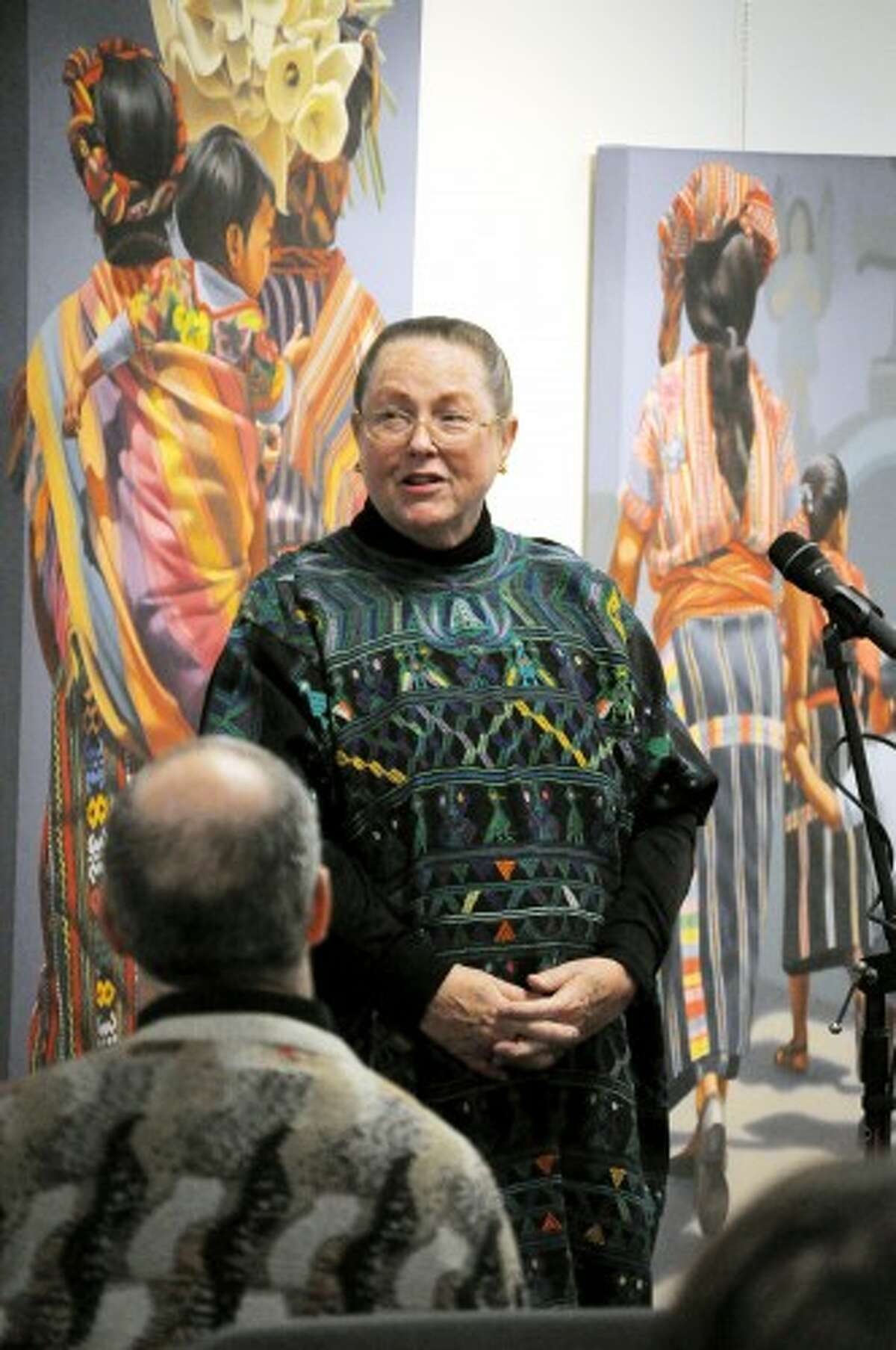 OPENING REMARKS: Chicago artist Winifred Godfrey gives the keynote address on Monday at the 2012 Festival of the Arts opening reception at Artworks. Her paintings of a Mayan funeral procession will be on display until Feb. 25. (Pioneer photo/Kyle Leppek)