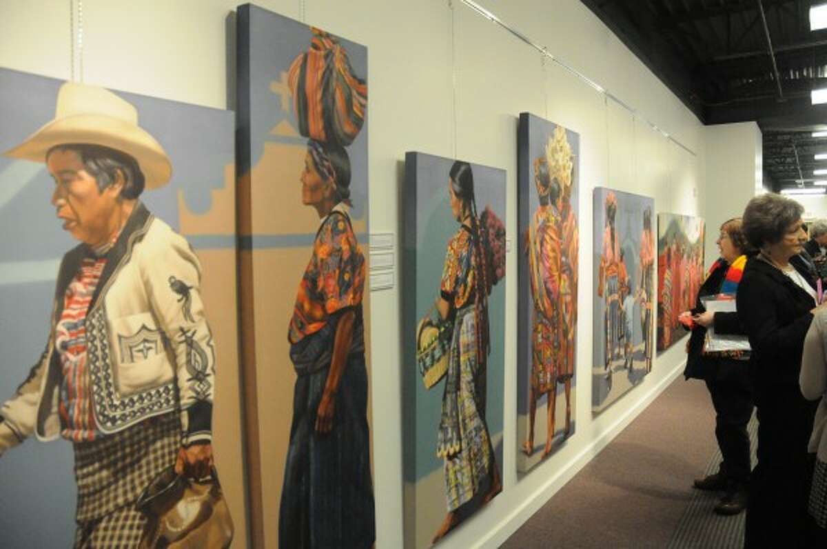 CULTURE: After a trip to Guatemala in the mid-70s, artist Winifred Godfrey became intrigued by the indigenous dress of each Mayan village in the country. She displays that interest through 14 life-size paintings of a Mayan funeral procession on display at Artworks in Big Rapids. (Pioneer photo/Kyle Leppek)