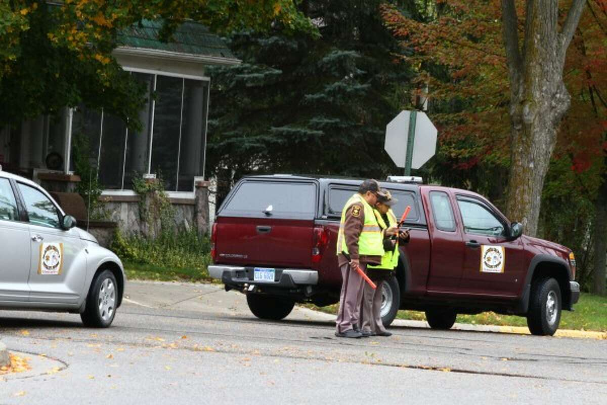 NO ENTRY: Members of the Mecosta County Sheriff's Office posse block a portion of Woodward Avenue during Tuesday's training exercise to locate a missing child. (Pioneer photos/Emily Grove-Davis)