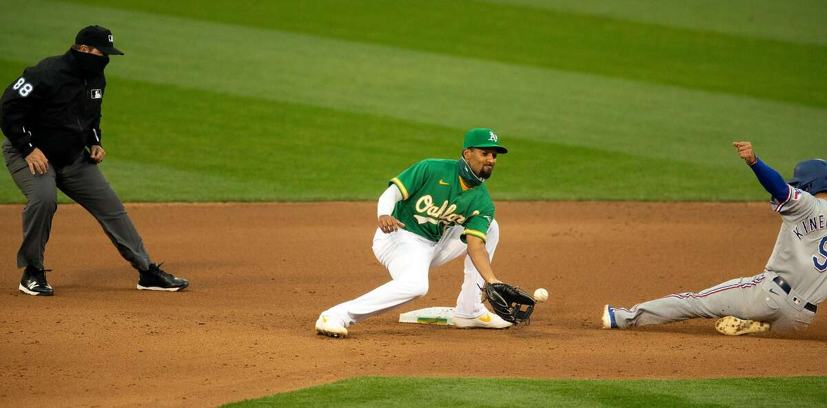 Texas Rangers� Isiah Kiner-Falefa (9) slides safely into second base with a steal ahead of the relay to Oakland Athletics shortstop Marcus Semien (10) during the fourth inning of a Major League Baseball game on Wednesday, Aug. 5, 2020 in Oakland, Calif. Umpire is Doug Eddings.
