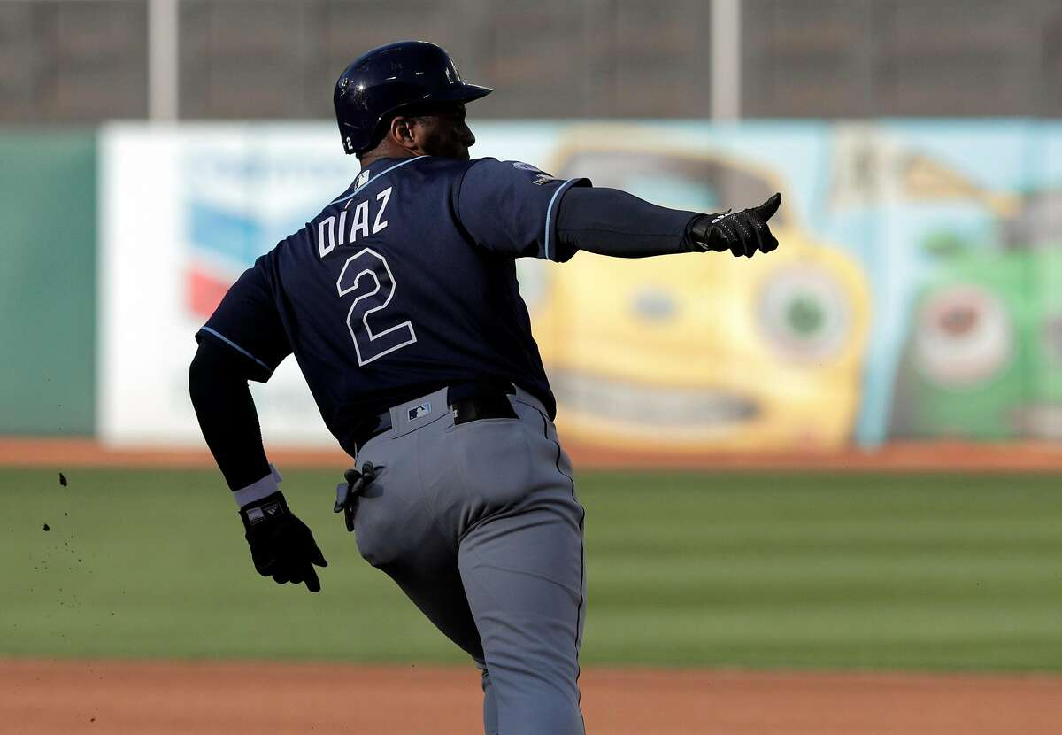 Yandy Diaz (2) gestures as he rounds the bases on his lead off home run in the first inning as the Oakland Athletics played the Tampa Bay Rays at the Oakland Coliseum in the AL Wild Card playoff game in Oakland, Calif., on Wednesday, October 2, 2019.