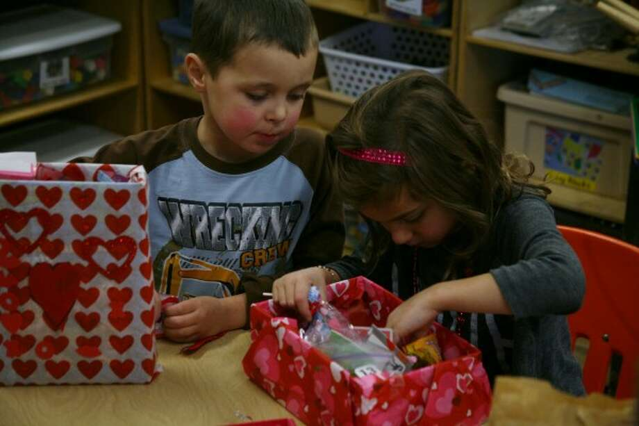 CUPID'S ARROW: Classmates in Ms. Bucholtz's kindergarten class at Riverview sort through their valentines and candy.