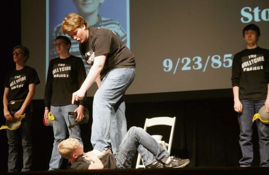 """BULLYCIDE: Trust Theatre Ensemble actors portray the story of Jared High, who committed suicide at age 13. His mother, Brenda, wrote the book, """"Bullycide in America,"""" which is what inspired Lori Thompson to direct """"The Bullycide Project."""" (Pioneer photos/Lauren Fitch)"""