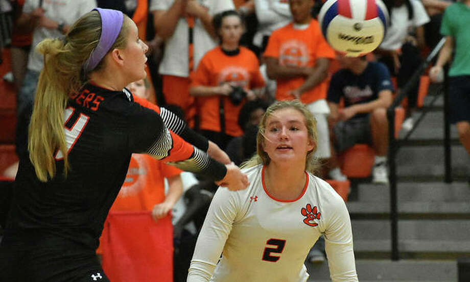 In this file photo, Edwardsville's Maddie Isringhausen receives the ball during Tuesday's win over O'Fallon. The Tigers lost at Cor Jesu on Wednesday.